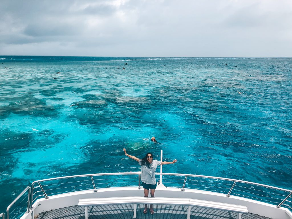 Me standing on a boat in Australia at the Great Barrier Reef