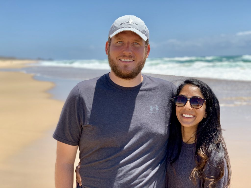 a picture of me and my husband on a beach in australia