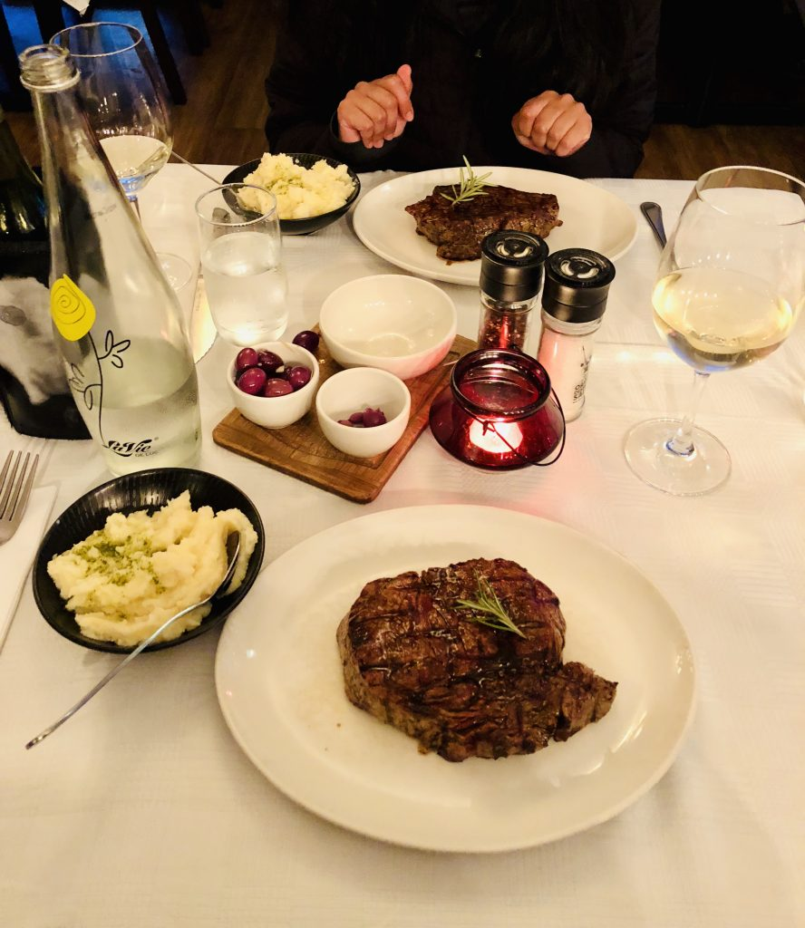 a photo of the delicious steak and wine I had at Hussar Grill.