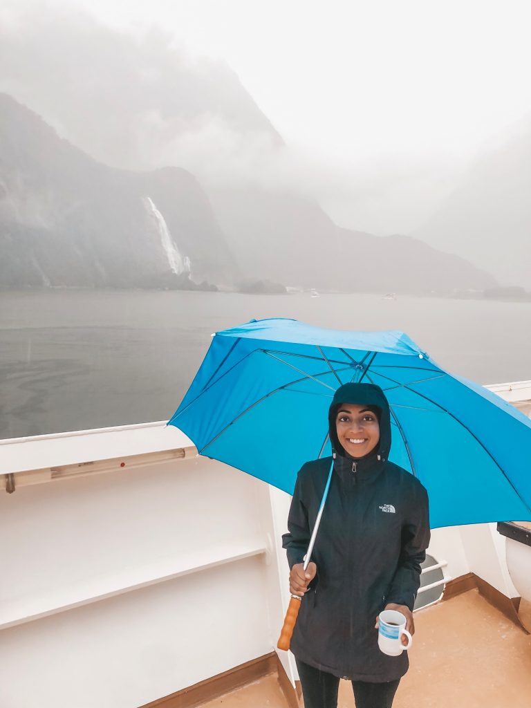 A photo of me wearing a black rainjacket that I take with me everywhere.