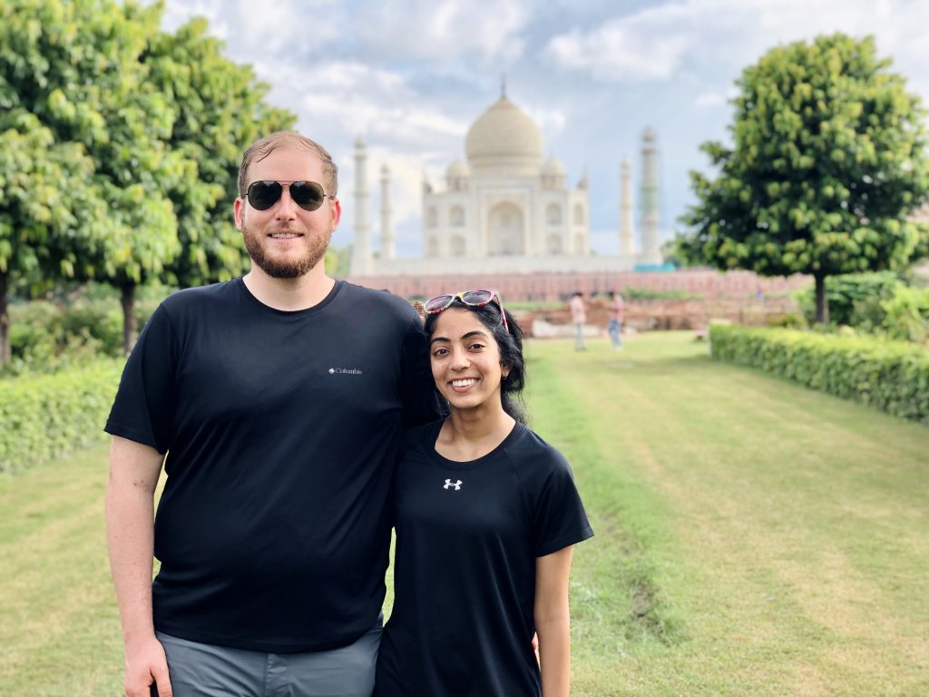 A photo of us standing in front of the Taj Mahal.