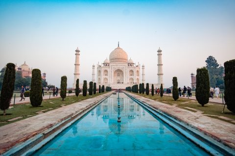 A photo of the Taj Mahal with a reflection pool.