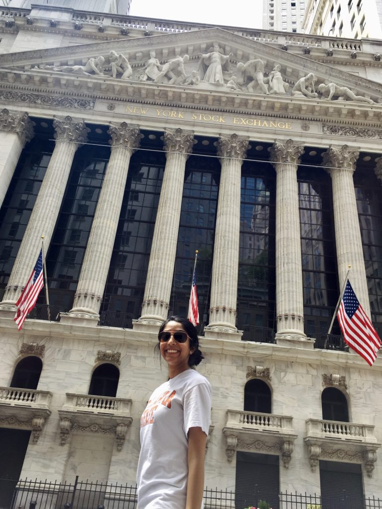 Me standing in front of the stock exchange in New York City — add this on your three-day itinerary for New York City