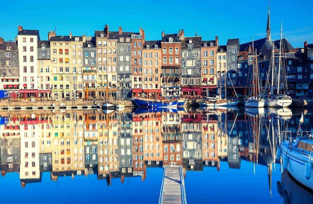 Add Honfleur to the list of best beach towns to visit in France.
